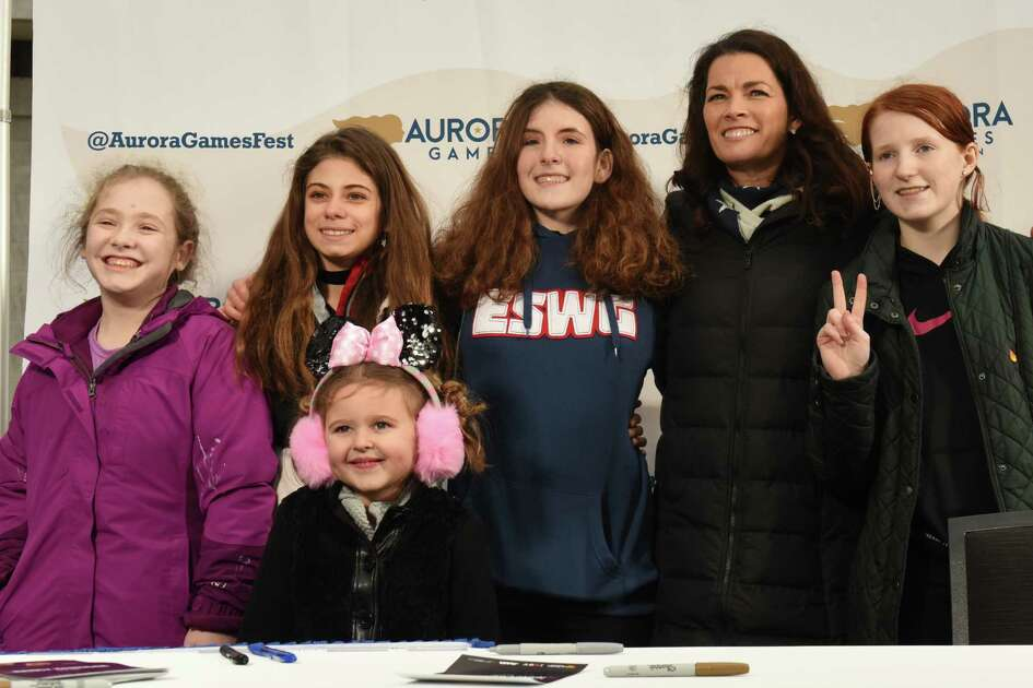 Members of the Hudson Mohawk Figure Skating Club get their photo taken with two-time Olympic figure skating medalist Nancy Kerrigan during a special appearance at the Empire State Plaza on Thursday, Feb. 7, 2019 in Albany, N.Y. Kerrigan serves as the Figure Skating Chair on the Aurora Games Advisory Board. (Lori Van Buren/Times Union)