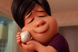 "A mother coddles her little ""dumpling"" - only in this case, the endearment is literal - in the short film ""Bao,"" the first Pixar film directed by a woman to be nominated. MUST CREDIT: Walt Disney Studios Motion Pictures/Pixar Animation Studios"