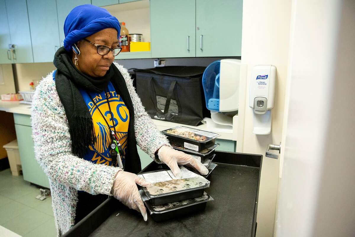 Alloise Jackson-Riley, assistant director at the Hummingbird Psychiatric Respite Navigation Center at San Francisco General Hospital, prepares meals for clients on Thursday, Feb. 7, 2019, in San Francisco, Calif.