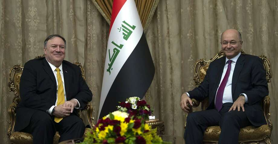 US Secretary of State Mike Pompeo, left, meets with Iraq's President Barham Salih in Baghdad, during a Middle East tour, on Jan. 9. President Trump's statements on U.S. troops in Iraq being able to fight in Syria and a base there as a way to watch Iran have predictably caused domestic problems for the Iraqi president. Photo: ANDREW CABALLERO-REYNOLDS /AFP /TNS / Getty Images