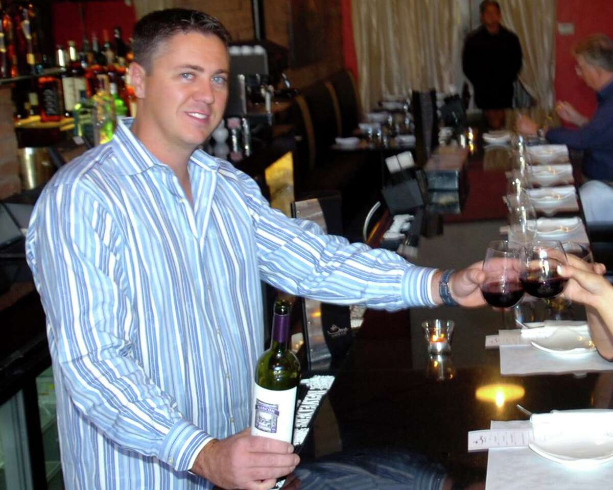Joe Tiago, owner, shares a toast with co-managers Lauren DeCaprio and Samantha Mauro at Bare Tapas in Bridgeport, Conn. Nov. 1st, 2011.