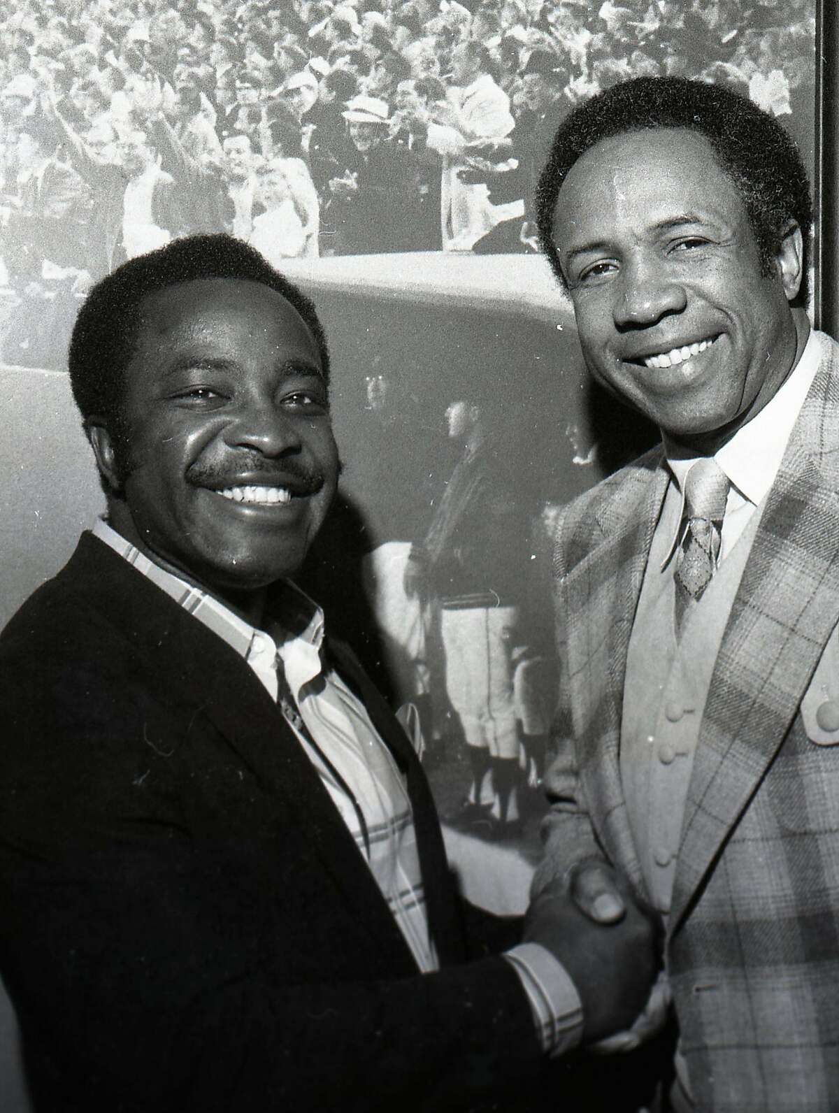 Manager Frank Robinson greets Joe Morgan after the second baseman signed with the Giants in February 1981.