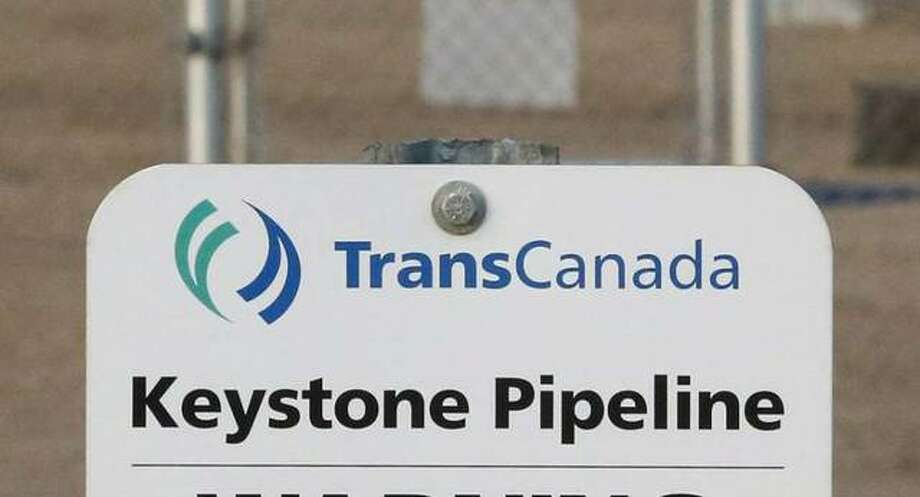 This Nov. 6, 2015, file photo shows a sign for TransCanada's Keystone pipeline facilities. Photo: Jeff McIntosh | The Canadian Press Via AP, File