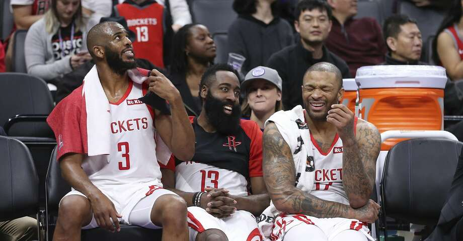 Houston Rockets' Chris Paul, left, James Harden, center and P.J. Tucker relax on the bench during closing moments of the team's 127-101 win over the Sacramento Kings in an NBA basketball game Wednesday, Feb. 6, 2019, in Sacramento, Calif. (AP Photo/Rich Pedroncelli) Photo: Rich Pedroncelli/Associated Press