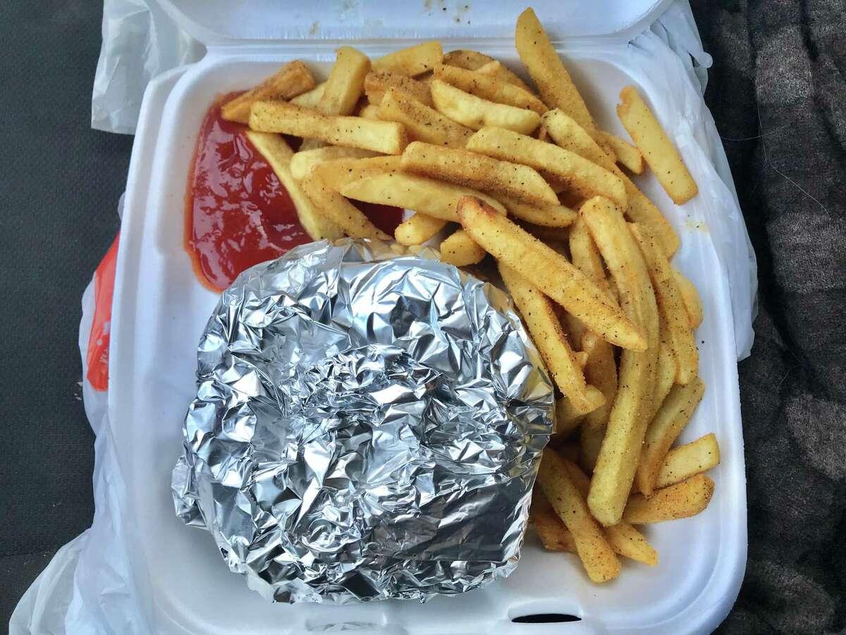 Cheeseburger combo with seasoned fries at Chief Cajun Big Baby Hamburgers