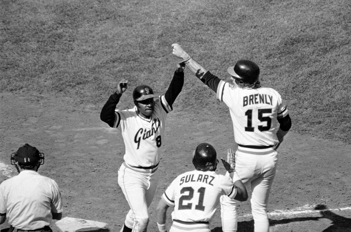 San Francisco Giants Joe Morgan (8) is congratulated at the plate by teammates Guy Sularz and Bob Brenly, after Morgan hit a three run homer over the right field fence in the seventh inning against the Los Angeles Dodgers, Oct. 4, 1982 at Candlestick Park in San Francisco, Calif.