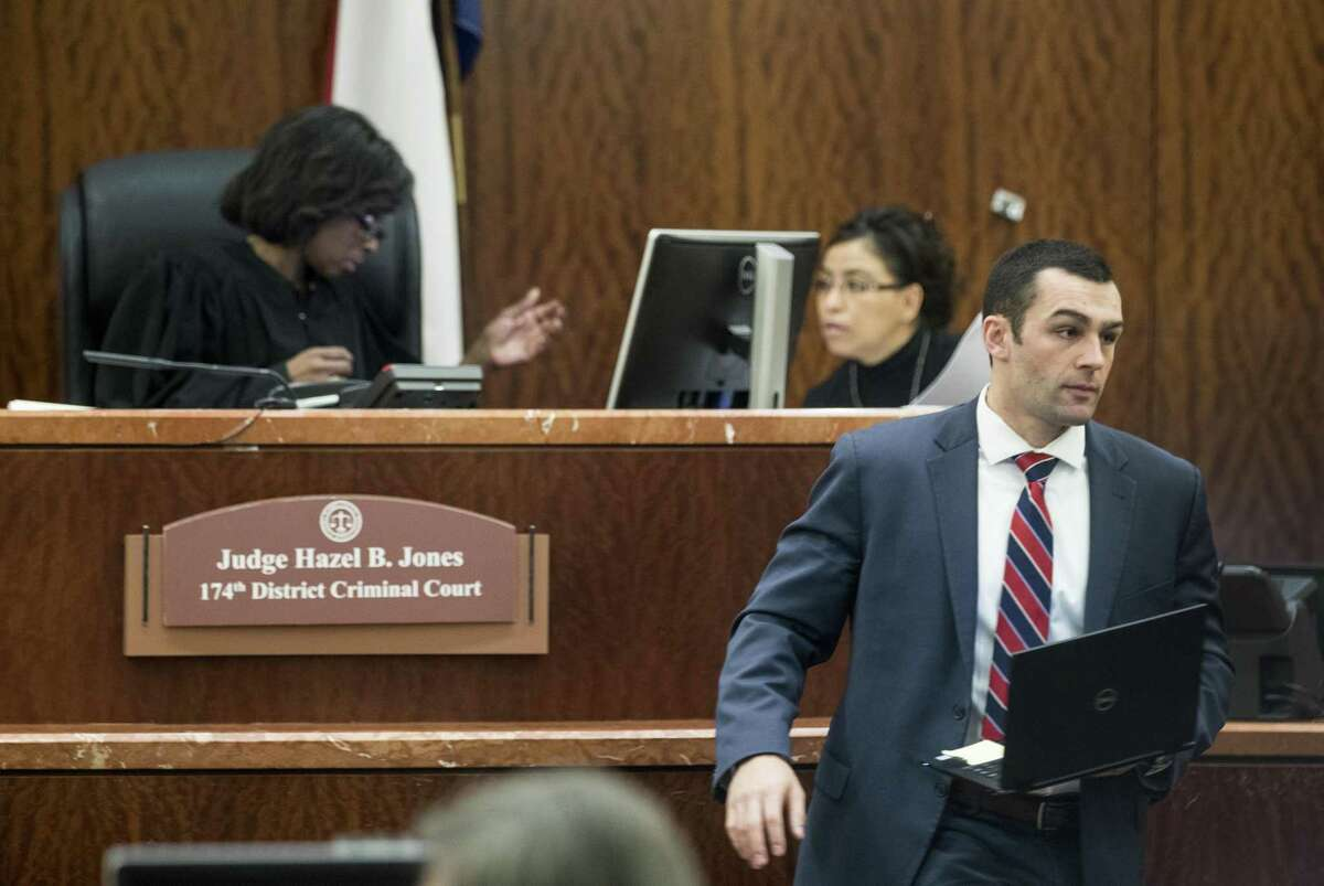 Assistant District Attorney Michael Hanover walks away from the bench in Judge Hazel Jones' courtroom in the 174th Criminal District Court on Wednesday, Feb. 6, 2019, in Houston. Harris County District Attorney Kim Ogg is asking Commissioners Court for 100 new prosecutors to help clear a felony case backlog that was exacerbated by Hurricane Harvey. She is clashing with fellow Democrats on Commissioners Court, who appear wary of beefing up the disstrict attorney's office after two ran on a platform that included criminal justice reform.