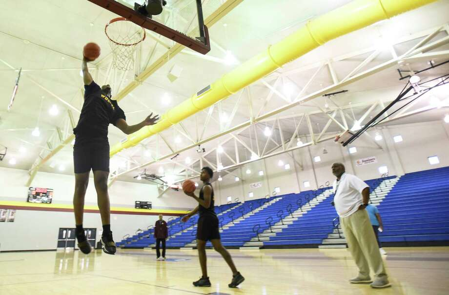 Beaumont United's Justin Pleasant goes for a dunk during the team's practice in their gym on Thursday.