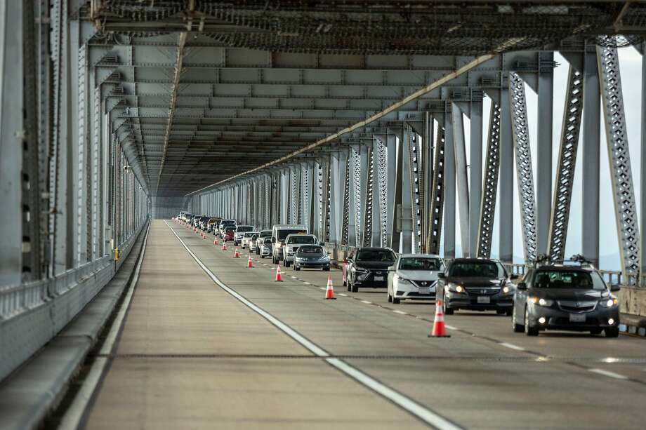 Traffic being limited to one lane of the lower deck of the Richmond-San Rafael bridge as they pass the area area where chunks of concrete broke loose and fell to the lower deck roadway, causing Caltrans to close the bridge in both directions until the could make inspections to deal the bridge safe, Richmond, California, USA 7 Feb 2019. (Peter DaSilva/Special to The Chronicle) Photo: Peter DaSilva, Special To The Chronicle