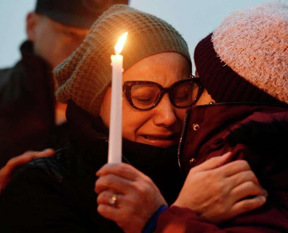 Valerie Reyes' mother, Norma Sanchez, of New Rochelle, N.Y., grieves for her daughter during a candlight vigil in Reyes' honor at Glen Island Park in New Rochelle, N.Y. Thursday, Feb. 7, 2019. Valerie Reyes, 24, of New Rochelle, N.Y., was found bound inside of a suitcase just off of Glenville Road in a quiet, wooded area of Greenwich, Conn. on Tuesday morning. Photo: Tyler Sizemore / Hearst Connecticut Media / Greenwich Time
