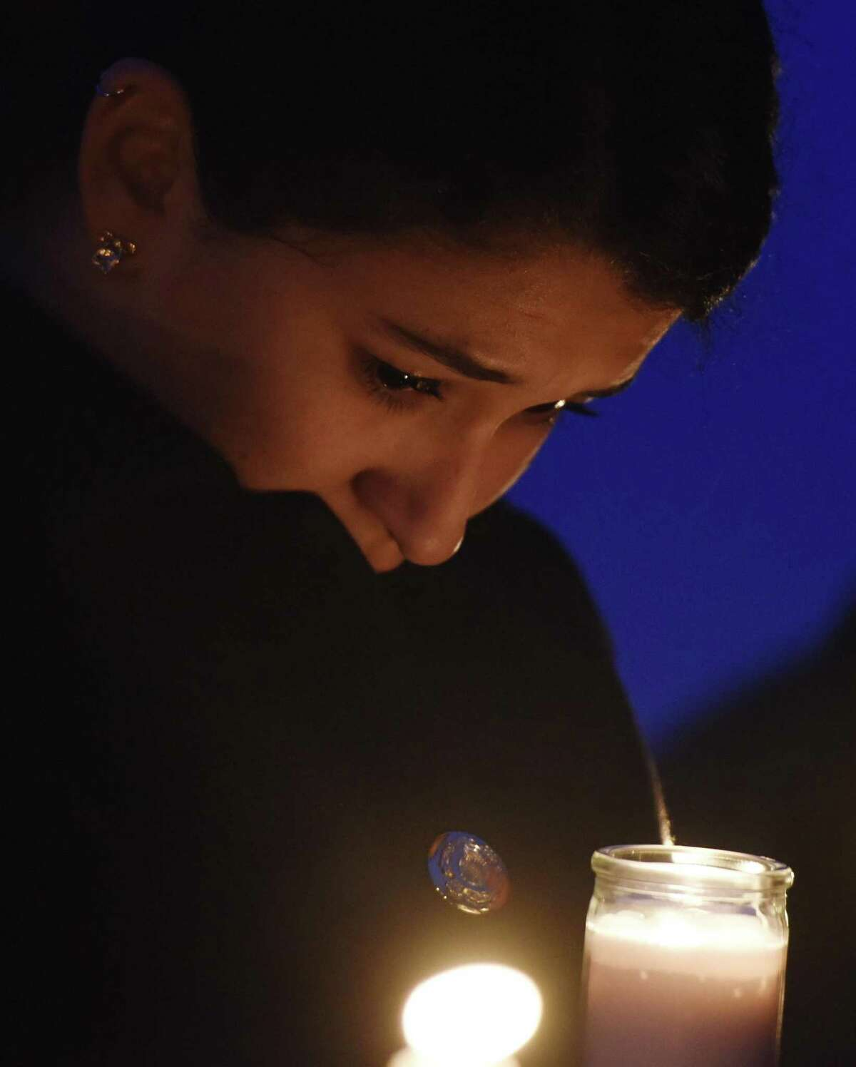 Friends and family grieve for homicide victim Valerie Reyes during a candleight vigil in her honor at Glen Island Park in New Rochelle, N.Y. Thursday, Feb. 7, 2019. Reyes, 24, of New Rochelle, N.Y., was found bound inside of a suitcase just off of Glenville Road in a quiet, wooded area of Greenwich, Conn. on Tuesday morning.