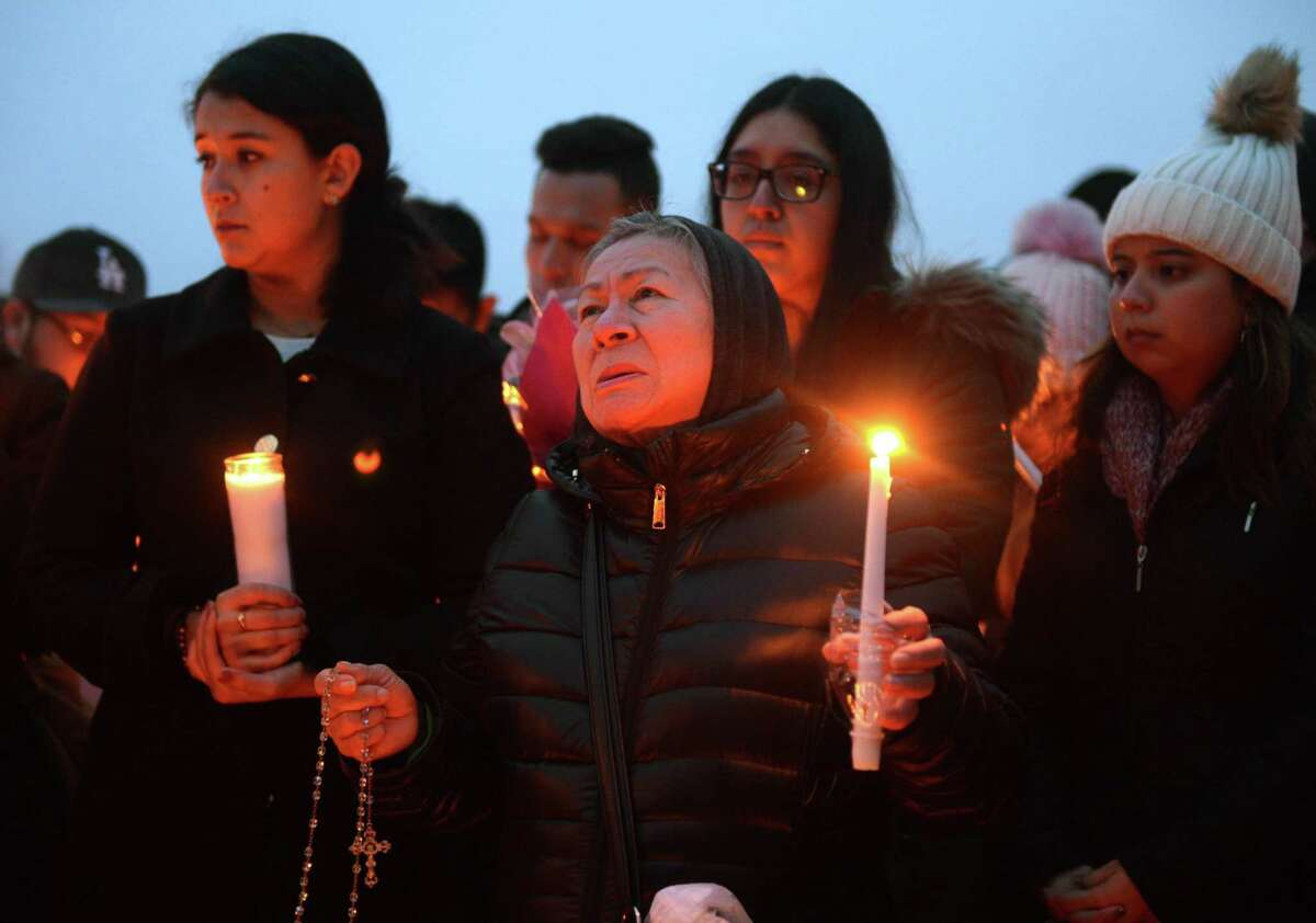 Friends and family grieve for homicide victim Valerie Reyes during a candlight vigil in her honor at Glen Island Park in New Rochelle, N.Y. Thursday, Feb. 7, 2019. Reyes, 24, of New Rochelle, N.Y., was found bound inside of a suitcase just off of Glenville Road in a quiet, wooded area of Greenwich, Conn. on Tuesday morning.