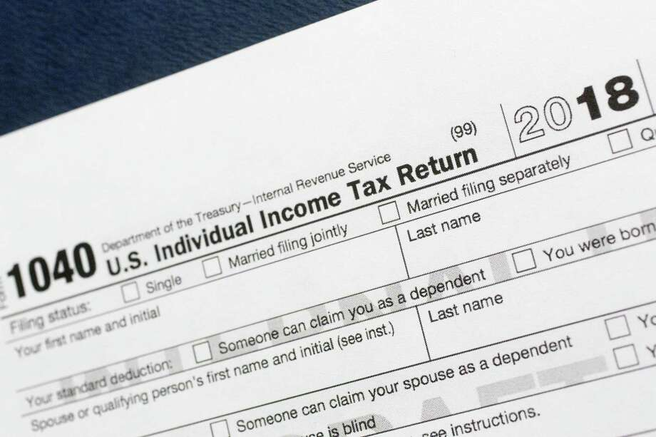 The 1040 U.S. Individual Income Tax Return form for 2018. Photo: Mark Lennihan, STF / Associated Press / Copyright 2018 The Associated Press. All rights reserved.