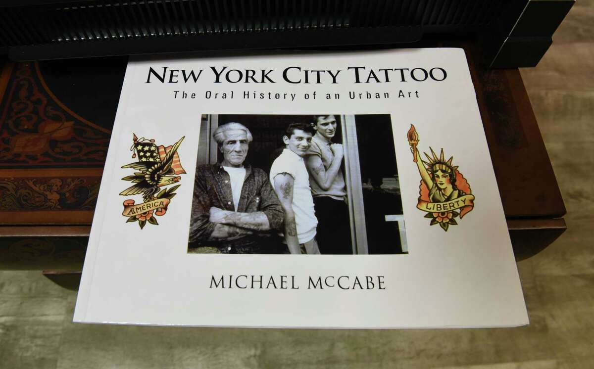 Book in The Curly Wolf Tattoo Club on Wednesday, Feb. 6, 2019 in Albany, N.Y. (Lori Van Buren/Times Union)