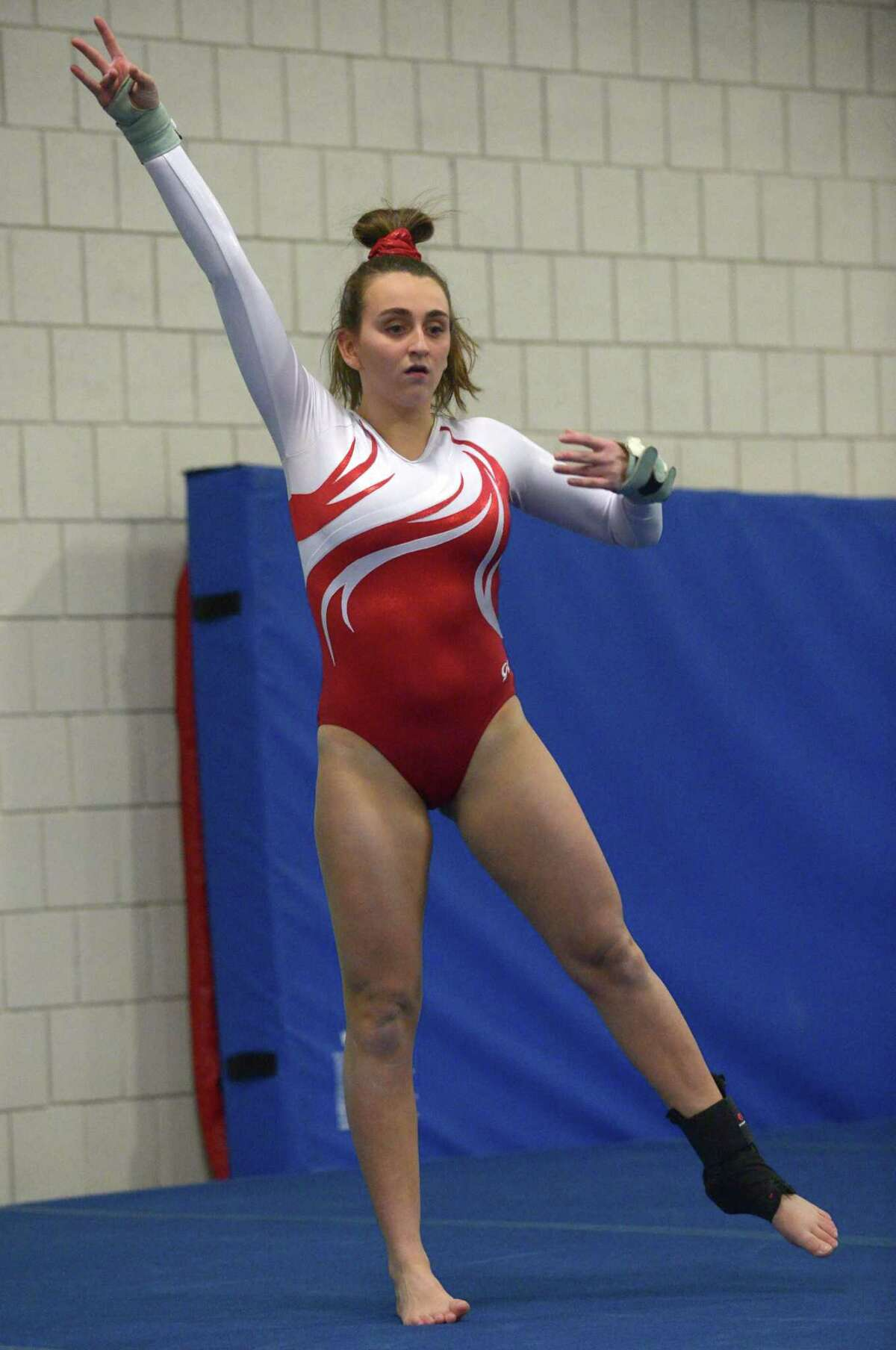 Greenwich's Gianna Cardini competes in her floor exercise against Wilton on Jan. 4 in Wilton.