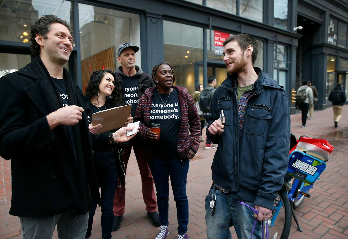 Kevin Adler (left) and his team from Miracle Messages reaches out to Brad Urmston-Parish (right), who is originally from New Jersey and was released from jail a day earlier, in San Francisco, Calif. on Tuesday, Jan. 29, 2019. At left is Brian Whitten, another community ambassador. Miracle Messages reconnects homeless people living on the street with long lost relatives and loved ones.