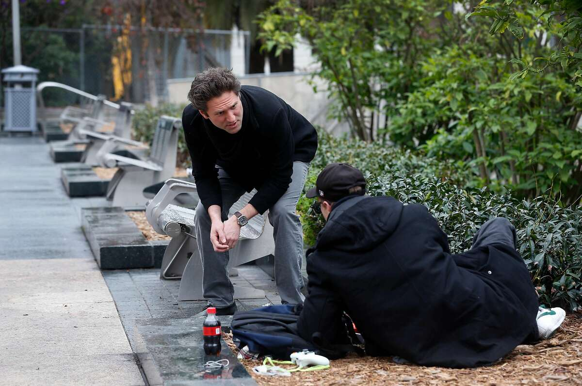 Miracle Messages founder and CEO Kevin Adler encounters a homeless man sitting in Union Square in San Francisco, Calif. on Tuesday, Jan. 29, 2019. Miracle Messages reconnects people living on the street with long lost relatives and loved ones.