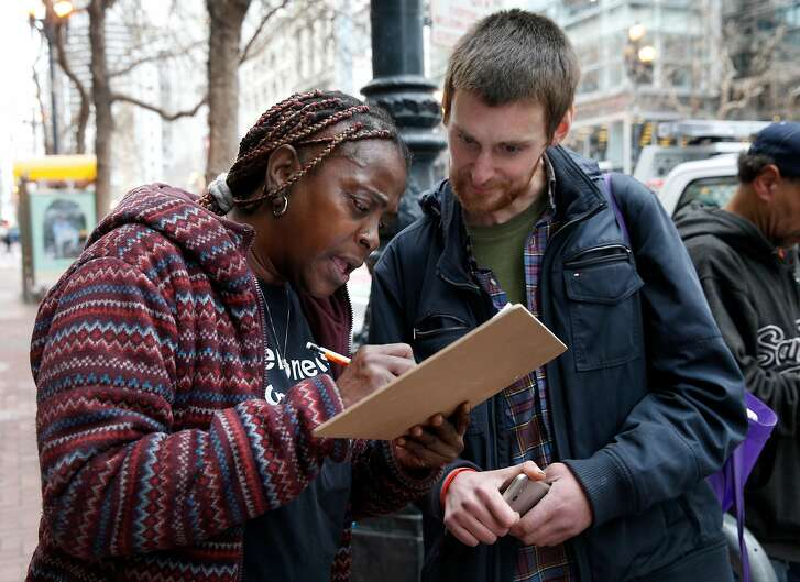 Beverly Stevenson, a community ambassador for Miracle Messages, fills out an intake form for Brad Urmston-Parish, who is originally from New Jersey and was released from jail a day earlier, in San Francisco, Calif. on Tuesday, Jan. 29, 2019. Miracle Messages reconnects homeless people living on the street with long lost relatives and loved ones.