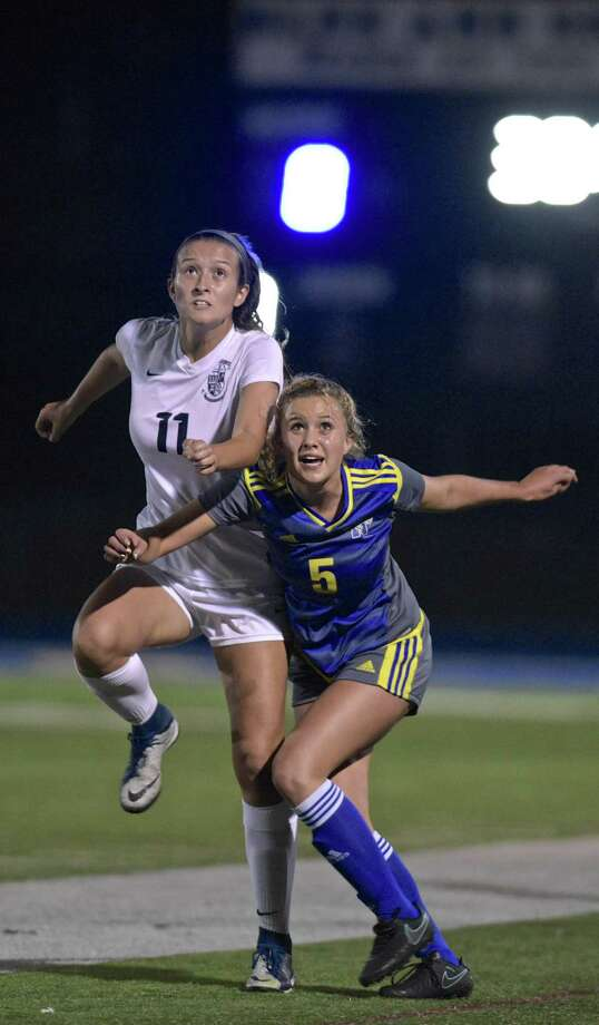 Immaculate's Kayla Mingachos (11) and Newtown's Keeley Kortze look to the ball during action on Oct. 9. Photo: H John Voorhees III / Hearst Connecticut Media / The News-Times