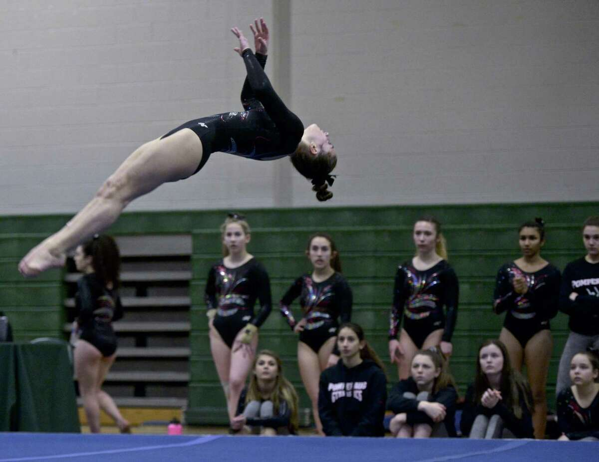 Pomperaug's Alaina Karp competes in the floor exercise during the SWC girls high school gymnastics championships at New Milford High School, New Milford, Conn, Thursday, February 7, 2019.