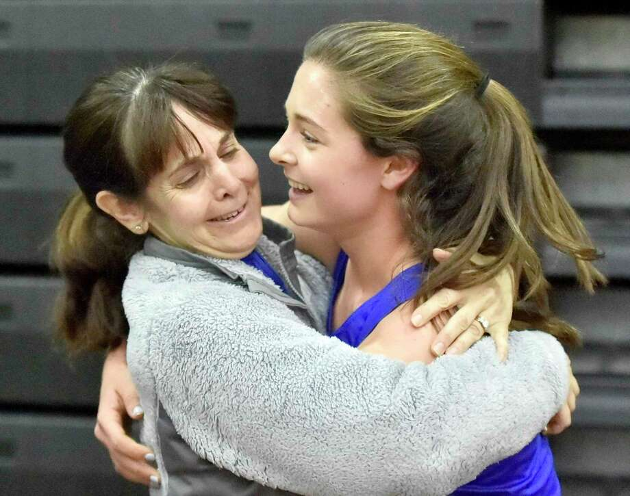 Old Saybrook's Grace Hanratty, right, is congratulated by her mother Kate after winning the 1000 meters at last season's Class S indoor track state championship. Photo: Peter Hvizdak / Hearst Connecticut Media / New Haven Register