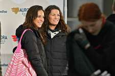 Fans get their photo taken with two-time Olympic figure skating medalist Nancy Kerrigan during a special appearance at the Empire State Plaza on Thursday, Feb. 7, 2019 in Albany, N.Y. Kerrigan serves as the Figure Skating Chair on the Aurora Games Advisory Board. (Lori Van Buren/Times Union)
