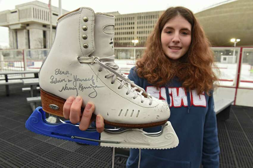 Skater Elena Kaplan, 15, of Menands had her skate signed by two-time Olympic figure skating medalist Nancy Kerrigan during a special appearance at the Empire State Plaza on Thursday, Feb. 7, 2019 in Albany, N.Y. Kerrigan serves as the Figure Skating Chair on the Aurora Games Advisory Board. (Lori Van Buren/Times Union)