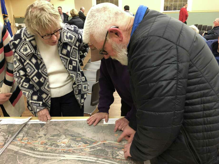 Residents look at maps of the proposed routes for the extension of the Sue Grossman Trail into downtown Torrington. Photo: Leslie Hutchison / Hearst Connecticut Media