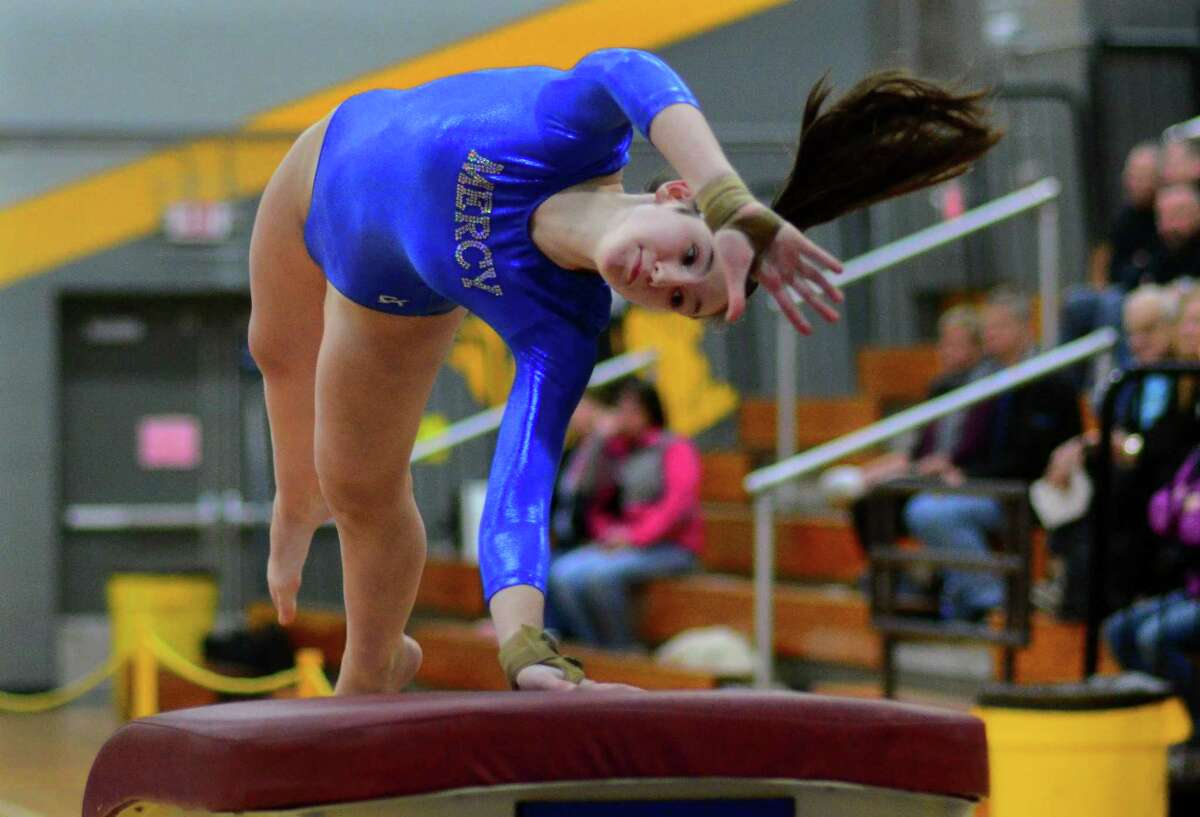 SCC gymnastics championship action at Jonathan Law in Milford, Conn., on Saturday Feb. 7, 2019.