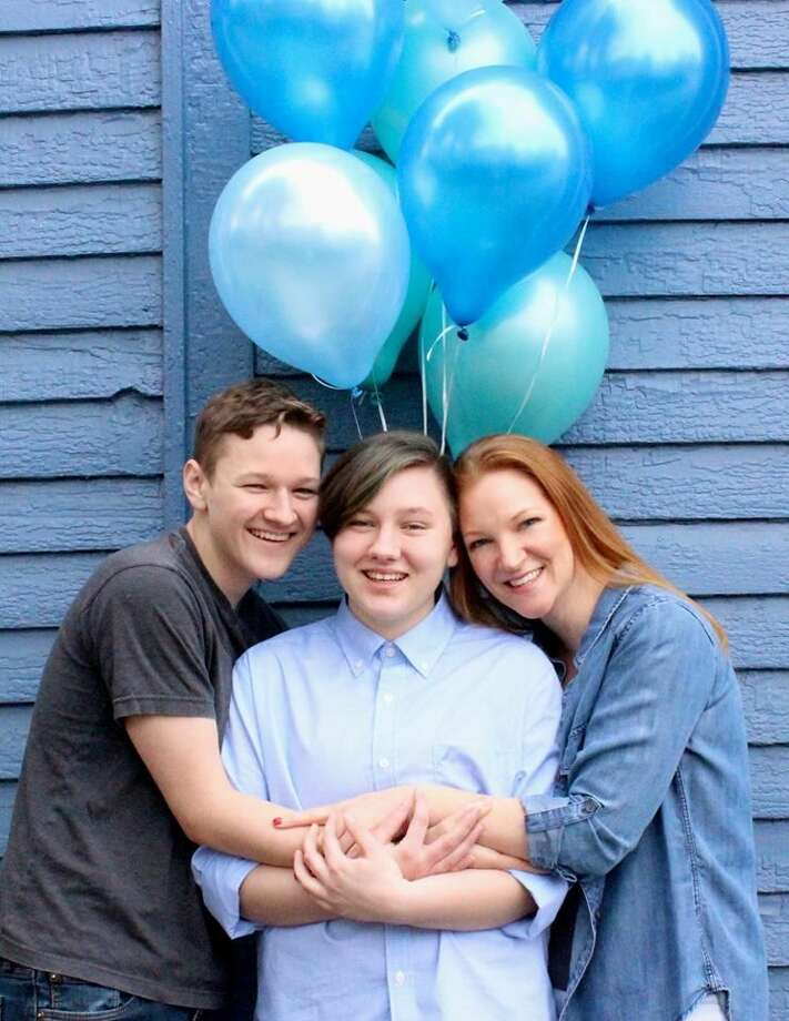 When Adrian Brown, 20, came out as transgender to his mother Heather Lundberg Green and younger brother Lucas, 17, his mom knew just what to do. She threw her son a transgender reveal celebration, complete with a photo shoot, glitter and blue balloons.