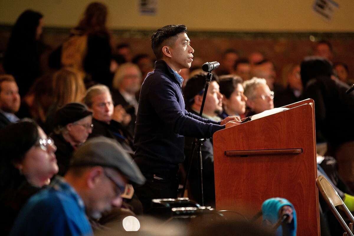 """Rogelio Foronda, Jr., project manager at Maximus Real Estate Partners, speaks to city planners and officials during a community meeting on the housing project often referred by critics as the """"Monster in the Mission,"""" on Thursday, Feb. 7, 2019, in San Francisco, Calif. The public meeting was held at Mission High School to hear public reaction on the housing project for 1979 Mission Street."""