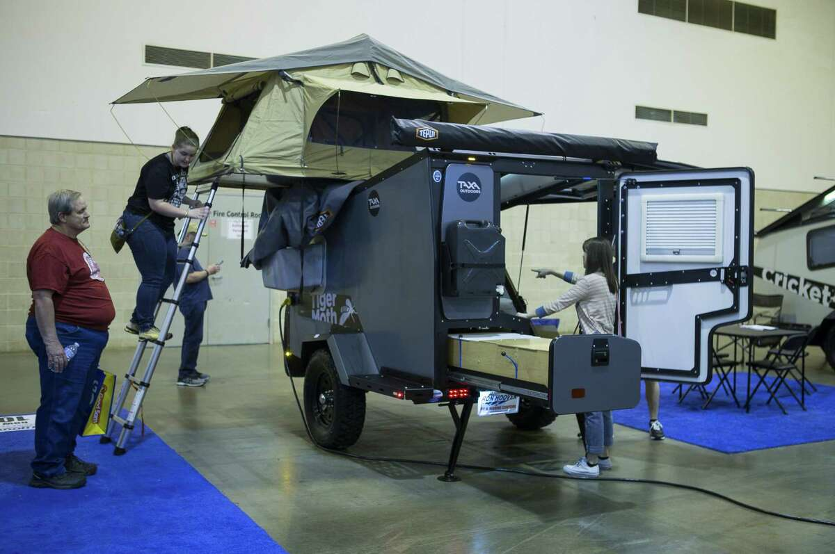 People check out a small trailer by TAXA Outdoors during the Houston RV Show at NRG Center, Wednesday, Feb. 6, 2019.
