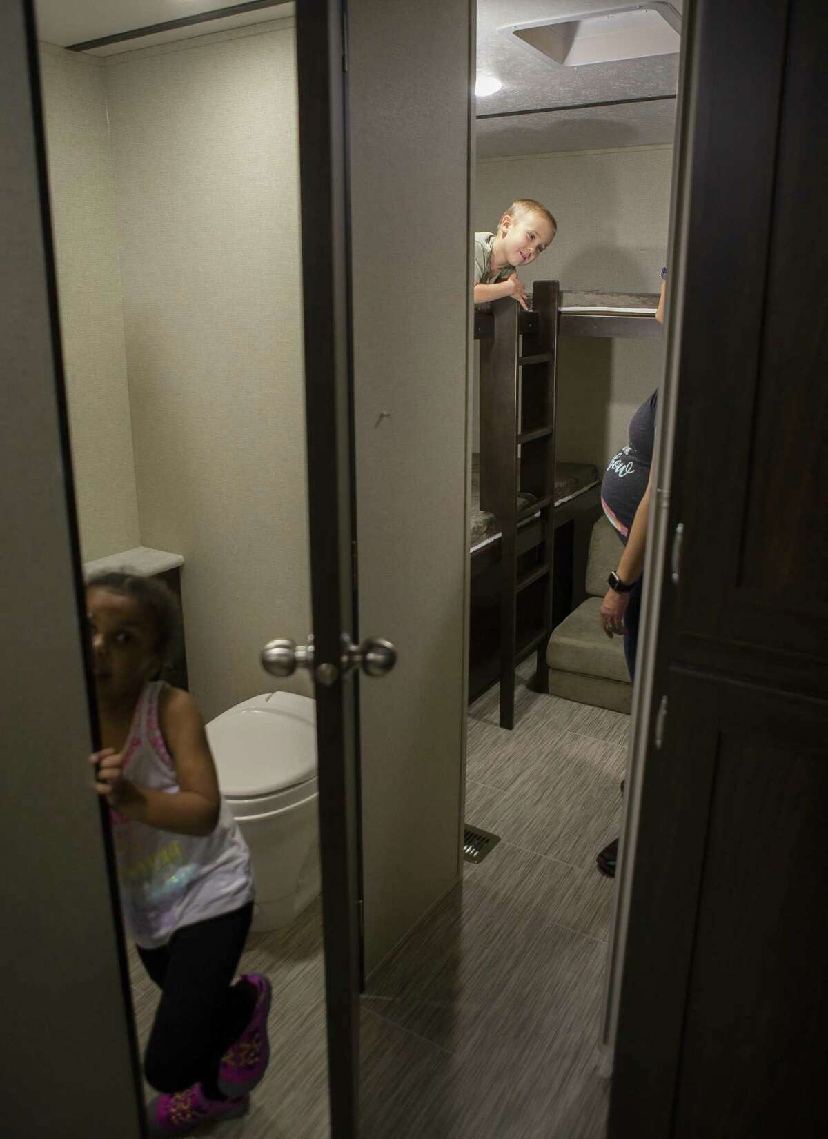Four year-old Wade Hall tries out the bunkbeds in a trailer while his sister, Shay, 5, checks out the bathroom as the siblings explore the RV show with their parents Clint and Laura Hall during the Houston RV Show at NRG Center, Wednesday, Feb. 6, 2019. The family has been on the look out for an RV to fit their family of five with one more child on the way.
