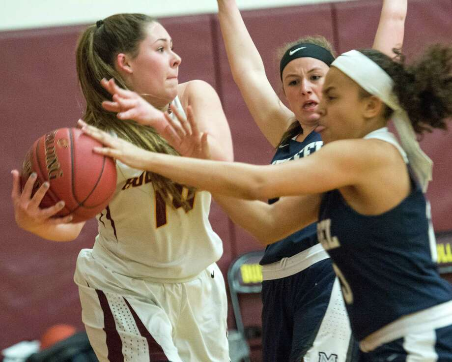 Berne-Knox-Westerlo junior Taylor Meacham grabs a rebound in front of two Mekeel Christian Academy players during a Western Athletic Conference matchup on Thursday, Feb. 7, 2019. (Jim Franco / Special to the Times Union)