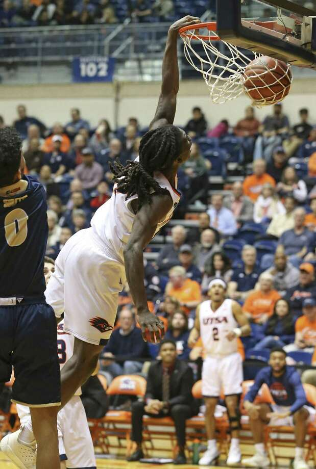 Keaton Wallace puts an exclamation point on his performance with a slam dunk past Phillip Smith as UTSA hosts FIU at the Convocation Center on February 7, 2019. Photo: Tom Reel, Staff / Staff Photographer / 2019 SAN ANTONIO EXPRESS-NEWS