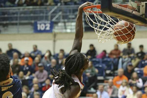 Keaton Wallace puts an exclamation point on his performance with a slam dunk past Phillip Smith as UTSA hosts FIU at the Convocation Center on February 7, 2019.
