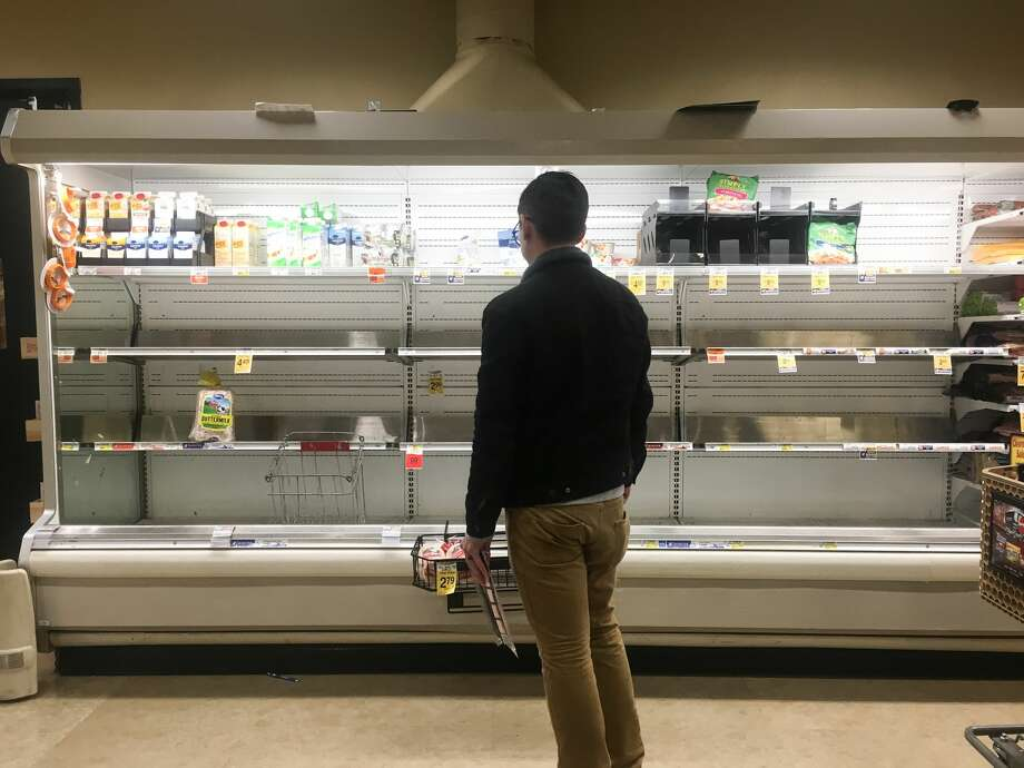 The dairy section at Safeway in White Center was emptied out except for lactose free milk as shoppers converged to stock up ahead of expected snow storms. Photo: GENNA MARTIN / SEATTLEPI