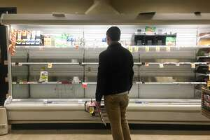 The dairy section at Safeway in White Center was emptied out except for lactose free milk as shoppers converged to stock up ahead of expected snow storms.