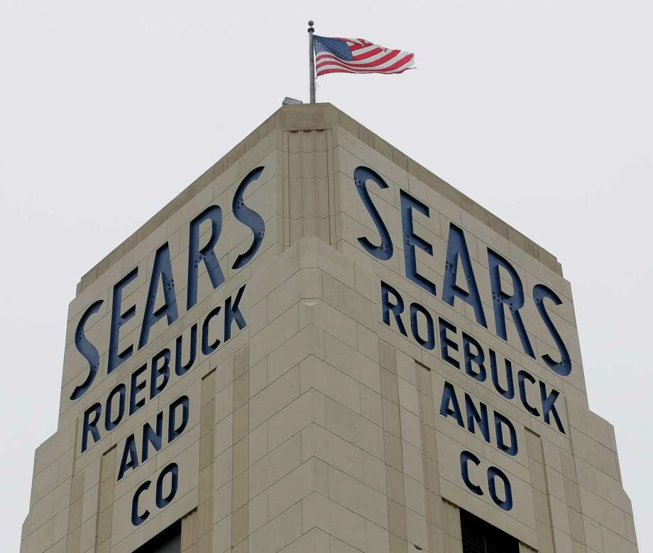 FILE- In this Jan. 8, 2019, file photo an American flag flies above a Sears store in Hackensack, N.J. A bankruptcy judge has blessed a $5.2 billion plan by Sears chairman and biggest shareholder Eddie Lampert to keep the iconic business going. The approval means roughly 425 stores and 45,000 jobs will be preserved. (AP Photo/Seth Wenig, File) Photo: Seth Wenig / Copyright 2019 The Associated Press. All rights reserved.
