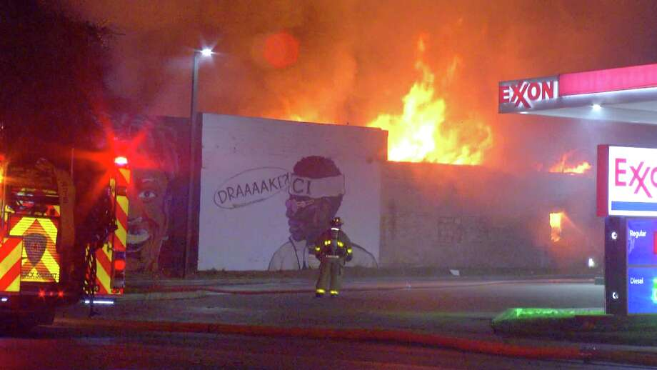 Firefighters responded to the blaze at about 4:20 a.m. in the 800 block of San Antonio, where they found Reggae Bar, Supremes Sports Bar and what was formerly Terror Mansion engulfed in flames. Photo: Ken Branca