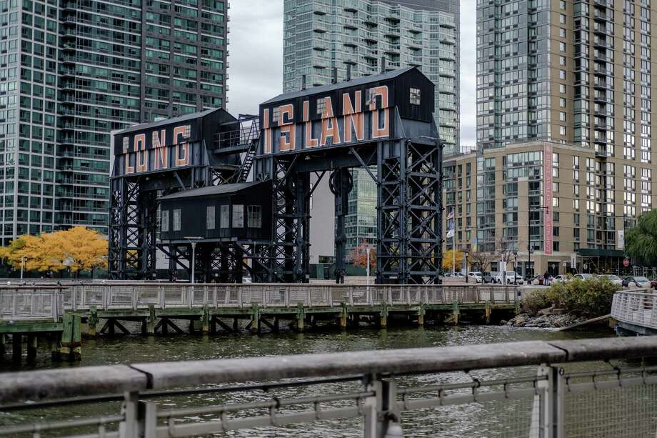 "A gantry that reads ""Long Island"" is seen from Gantry Plaza State Park in the Long Island City neighborhood in the Queens borough of New York on Nov. 9, 2018. Photo: Bloomberg Photo By Christopher Lee / Bloomberg"