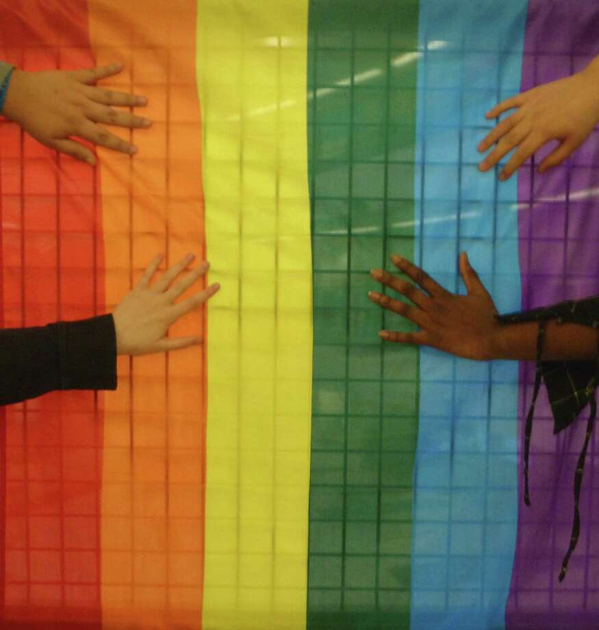 The Gay Straight Alliance is supposed to be anonymous, so students at Stamford's AITE took this photo showing their hands. Photo: Christine Bisceglie