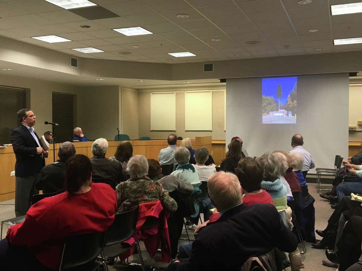 David Brennan, an attorney with Young/Sommer and local real estate counsel for Verizon, shows a crowd at the Colonie Zoning Board of Appeals what a proposed cell tower at 17 Elks Lane would look like on Thursday, Feb. 7, 2019.