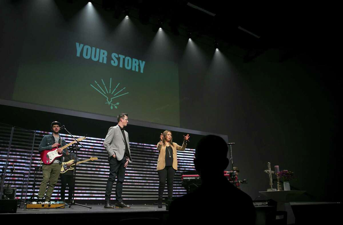 Eric and Geovanna Huffman make weekly announcements to their congregation at The Story Church during Sunday service on January 20, 2019, in Houston.