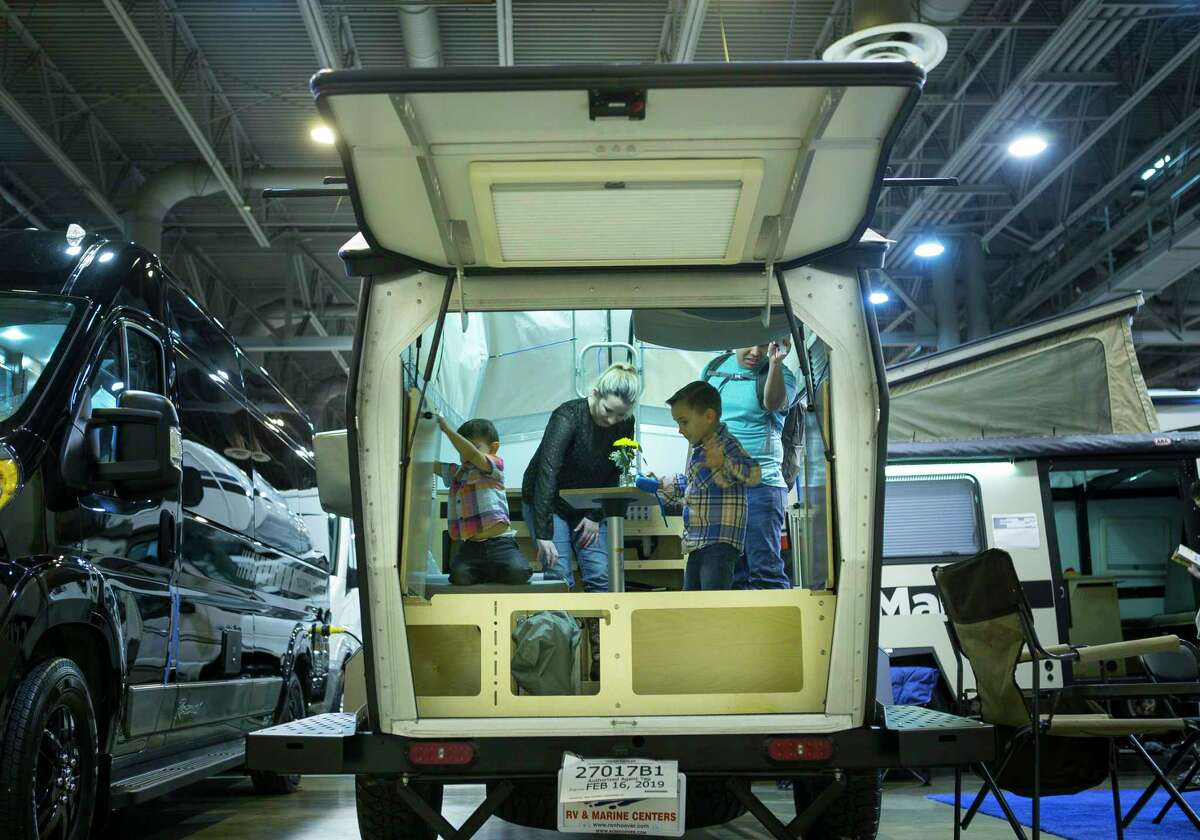 Rio and Ashton Cortez look at a small trailer by TAXA Outdoors with their two children Jason, 6, and Noah, 2, during the Houston RV Show at NRG Center, Wednesday, Feb. 6, 2019. The family has been interested in small to medium size trailers, and they made the drive to Houston from their home in San Antonio to attend the RV show Wednesday.