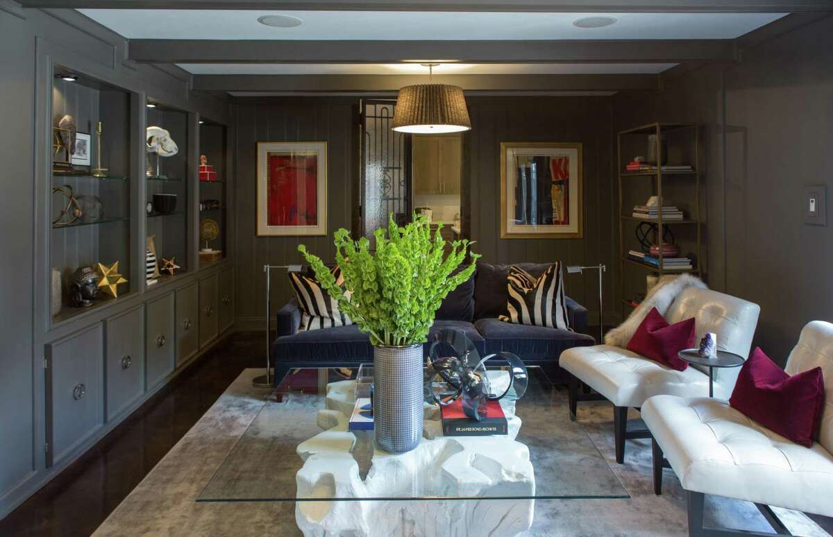 """Now: Roseann Rogers and Aashish Shah turned their 1960 ranch home in Del Monte II into a stylish and sophisticated home. Before, this living room -- or """"parlor"""" as they call it -- was very beige. In its makeover it was painted dark gray and filled with blue, white and gray furnishings."""