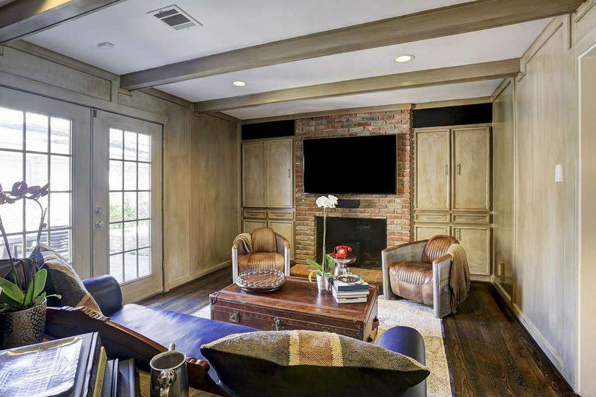 Then: Before, the parlor had creamy beige walls and furnishings in earth tones. The TV over the fireplace was replaced by a favorite piece of art.