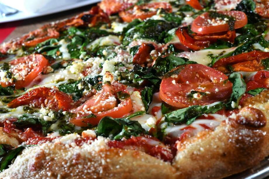 Mellow Mushroom, 4375 Dowlen Road, BeaumontPictured: Kosmic Karma pizza topped with  mozzarella, spinach, feta cheese, sun-dried tomatoes and Roma tomatoes. Photo: Guiseppe Barranco/The Enterprise