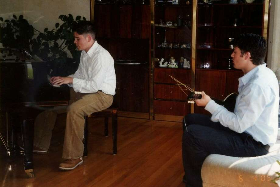 Mike and Bernadette Bonanno's first son, Jesse, (at 24) plays piano with their second son, Cory, (at 22) playing the guitar, in November 2008. (Susan Valletta)