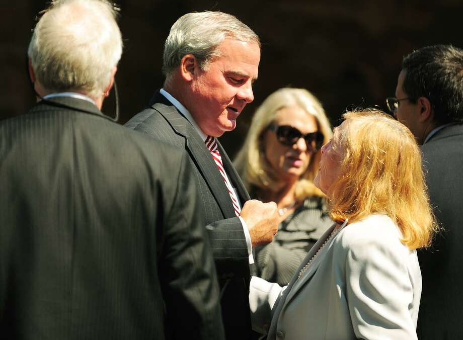 Former Governor John Rowland talks with family members outside the funeral service for former Lieutenant Governor Joseph Fauliso at St. Peter Claver Church in West Hartford in  2014. Photo: Hearst Connecticut Media File Photo / Connecticut Post